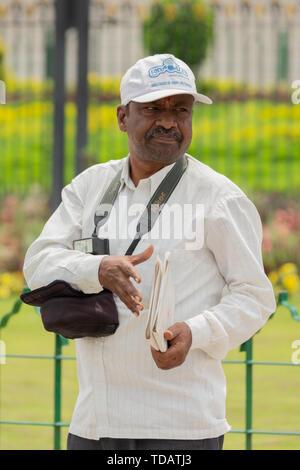 Bangalore, Karnataka India-June 04 2019 : Photographer at Vidhana soudha waiting for customers or people to taking picture. - Stock Photo