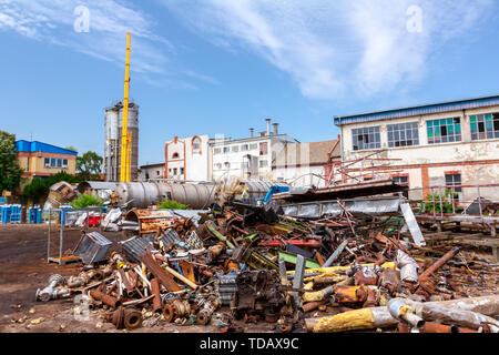 Piled up scrap metal, old profiles and equipment, parts of old industrial system, complex after cassation for recycling metal. - Stock Photo