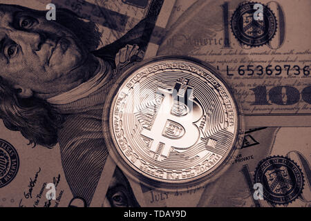 Golden Bitcoin on US dollars. Digital currency. - Stock Photo