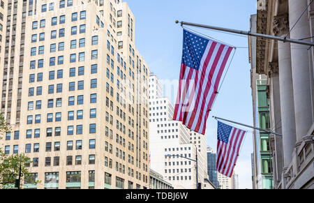 USA symbol in New York streets. American flags on a classical building, Manhattan downtown, business area