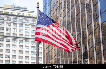 USA symbol in New York streets. American flag in Manhattan downtown, business high buildings background