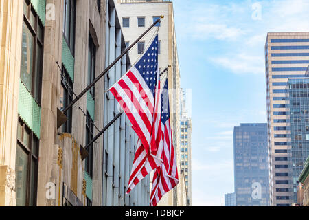 USA symbol in New York streets. American flags on a building facade, Manhattan downtown, business area