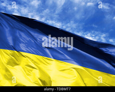 waving flag of Ukraine close up against blue sky - Stock Photo