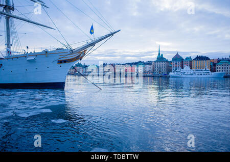 Winter view of Stockholm Old Town, Gamla Stan, and Riddarholm church with remnants of broken ice on the Baltic Sea. Hostel rooms are available on the  - Stock Photo