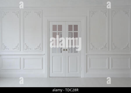 Luxurious bright interior of the living room in Baroque style with stucco and double door. - Stock Photo