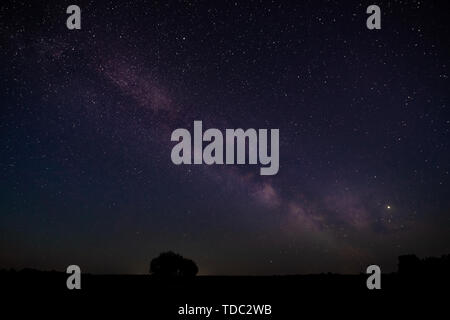 The summer Milky Way rises over the MacDonald Observatory near Fort Davis, Texas. - Stock Photo