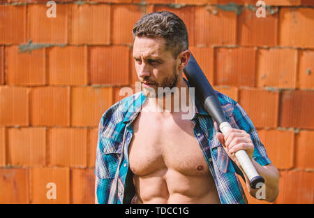 Hooligan man hits the bat. Bandit gang and conflict. aggression and anger. full of energy. unshaven muscular man fighting. man with baseball bat. i am a criminal. outdoor sport activity. Never stop. - Stock Photo
