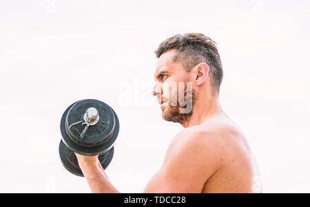 man sportsman weightlifting. steroids. fitness and sport equipment. Muscular man exercising in morning with barbell. athletic body. Dumbbell gym. success. Perfect biceps. Sport is the way of life. - Stock Photo