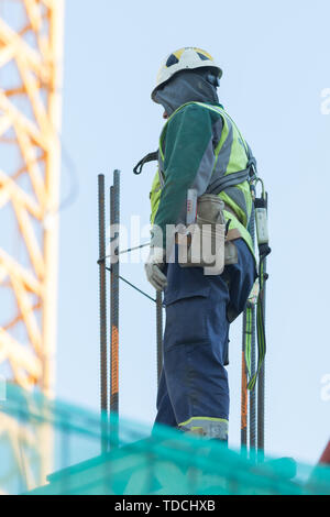 Engineer were walking up the stairs to survey the construction site. - Stock Photo