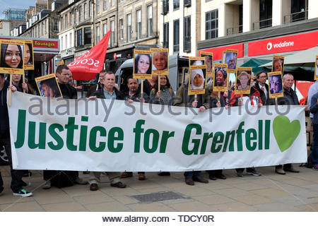 Edinburgh, Scotland, UK. 14th June 2019.  Silent Vigil for the Grenfell Fire disaster, in Castle Street Edinburgh. On the second anniversary of the Grenfell fire, campaigners hold a silent vigil.  Credit: Craig Brown - Stock Photo