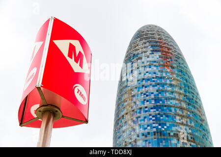 Barcelona, Spain - September 05, 2018: The Torre Glories, formerly known as Torre Agbar and an underground post in Barcelona, Spain - Stock Photo