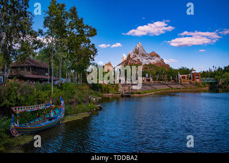 Orlando, Florida. April  29, 2019 Colorful boat , blue lake and Expedition Everest mountain in Animal Kingdom.