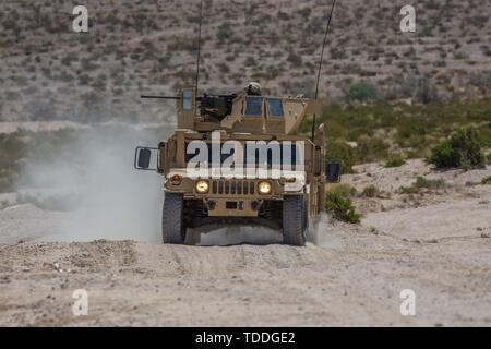 A Humvee with Engineer Company, Combat Logistics Battalion 23, 4th Marine Logistics Group, provides security for the main attack body of the mechanized assault course during Integrated Training Exercise 4-19 at Marine Corps Air Ground Combat Center, Twentynine Palms, Calif., June 12, 2019. Marine Forces Reserve units participate in ITX to both complete annual training requirements and to increase unit readiness and proficiency. (U.S. Marine Corps photo by Lance Cpl. Preston L. Morris) - Stock Photo