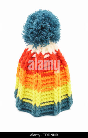 Colorful winter knitted hat on a white background. Handwork. Winter fashion concept for men, women and children. - Stock Photo