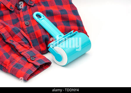 Sticky washable roller for cleaning clothes from animal hair and the pellet. Cleaning clothes and furniture from dust, wool, hair - Stock Photo