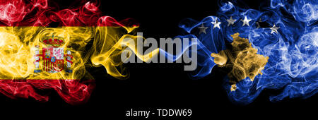 Spain vs Kosovo, Serbia smoky mystic flags placed side by side. Thick colored silky smokes flag of Spanish and Kosovo, Serbia - Stock Photo