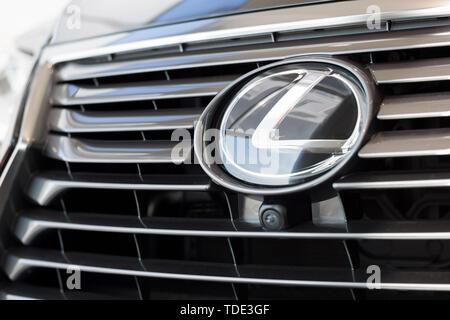 Russia, Izhevsk - April 21, 2018: Showroom Lexus. Logo of Lexus car on display in the Showroom. Famous world brand. - Stock Photo
