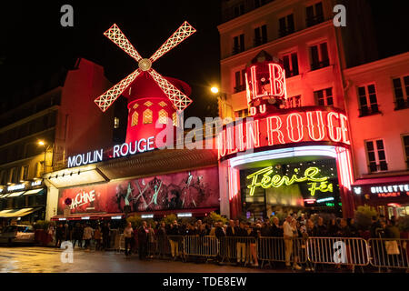 Paris, France, 15 May 2019 - Moulin Rouge is a famous wildmill and cabaret built in 1889, locating in the Paris red - light district of Pigalle - Stock Photo
