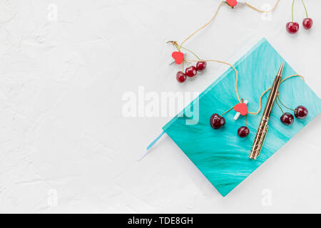 Notebook and red hearts isolated on beige background, copy space. Minimal flat lay with planning for Valentine day, love and romance concept, top view - Stock Photo