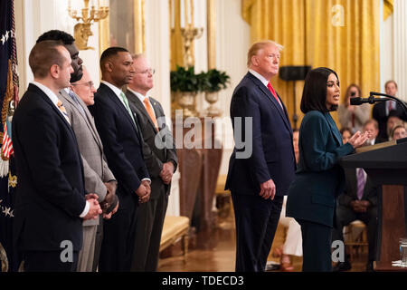 Washington, United States Of America. 13th June, 2019. President Donald J. Trump looks on as Kim Kardashian West delivers remarks on second chance hiring Thursday, June 13, 2019, in the East Room of the White House. People: President Donald Trump, Kim Kardashian Credit: Storms Media Group/Alamy Live News - Stock Photo