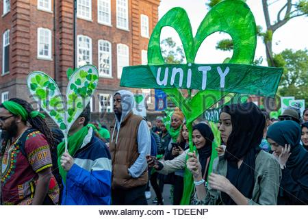 Gbr. 14th June, 2019. People march to mark the two-year anniversary of the Grenfell Tower block fire in London, Friday, June 14, 2019. Survivors, neighbors and politicians including London Mayor Sadiq Khan attended a church service of remembrance on Friday for the Grenfell Tower blaze, the deadliest fire on British soil since World War II. Credit: Vedat Xhymshiti/ZUMA Wire/Alamy Live News - Stock Photo