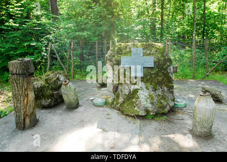 Memorial stone of Polish sappers on a site of briefing room, where Claus von Stauffenberg set a bomb, in Wolfsschanze (Wolf's Lair) in Gierloz, Poland - Stock Photo