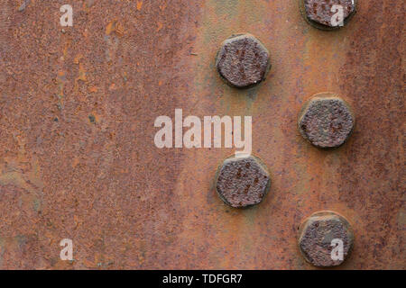 Rusty metal plate texture with bolts. Copy space. - Stock Photo