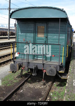 Old Abandoned Wooden Train Wagon, green coloured - Stock Photo