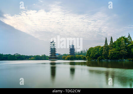 Morning Sun and Moon Twin Towers Park in Guilin, Guangxi, China - Stock Photo