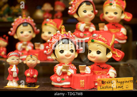 Close up of some beautiful chinese miniature figurine captured at the Central Market in Kuala Lumpur, Malaysia - Stock Photo