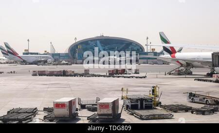 DUBAI, UNITED ARAB EMIRATES- AUGUST, 22, 2016: emirates airlines planes at dubai international airport in the united arab emirates - Stock Photo
