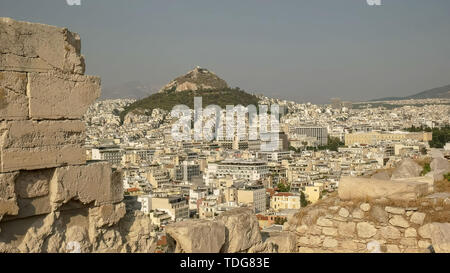 afternoon shot of lycabettus hill from the acropolis in athens, greece - Stock Photo