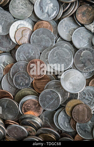 Close up of shiny coin money texture background with pile of American coins everywhere - including nickels, pennies, quarters, and dimes. Shows wealth - Stock Photo