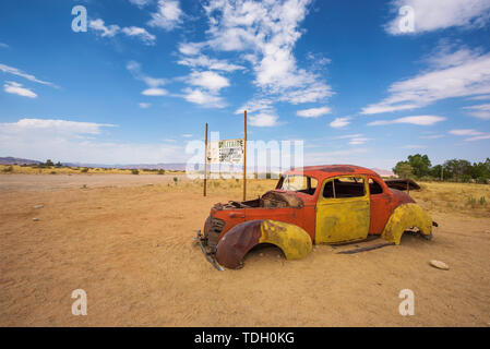 Abandoned car wreck in Solitaire located in the Namib Desert of Namibia - Stock Photo