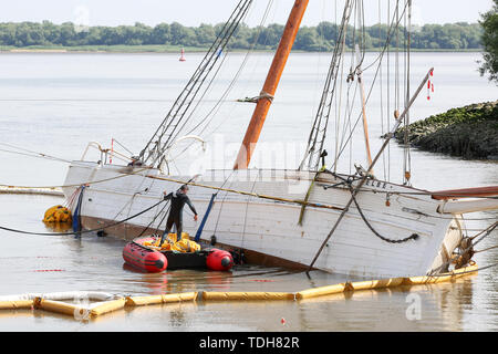 Stadersand, Germany. 16th June, 2019. Employees of a Spanish company prepare with divers the salvage of the sunken historic sailing ship 'No 5 Elbe' in the harbour of Stadersand. The historic sailing ship, which has only recently been extensively renovated, collided with a container ship on the Elbe and sank. Credit: Bodo Marks/dpa/Alamy Live News - Stock Photo