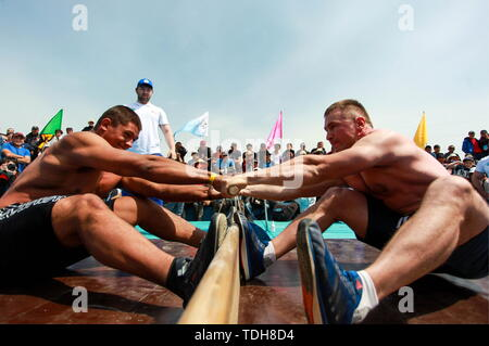 Irkutsk, Russia. 15th June, 2019. IRKUTSK REGION, RUSSIA - JUNE 15, 2019: Mas-wrestlers perform at the 7th Yordynian Games - Eurasian Peoples' Games, an ethnic and cultural festival of the local indigenous peoples, held at the foot of the sacred Mount Yord near Lake Baikal. Kirill Shipitsin/TASS Credit: ITAR-TASS News Agency/Alamy Live News - Stock Photo