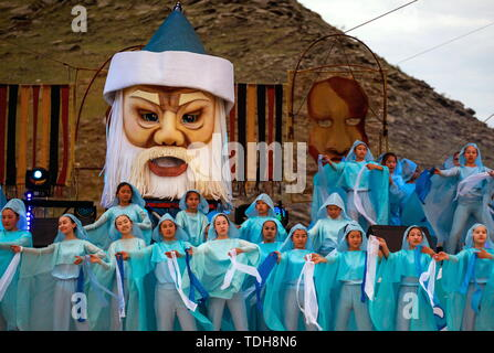 Irkutsk, Russia. 15th June, 2019. IRKUTSK REGION, RUSSIA - JUNE 15, 2019: Artists in traditional costumes perform at the 7th Yordynian Games - Eurasian Peoples' Games, an ethnic and cultural festival of the local indigenous peoples, held at the foot of the sacred Mount Yord near Lake Baikal. Kirill Shipitsin/TASS Credit: ITAR-TASS News Agency/Alamy Live News - Stock Photo