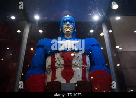 Malaga, Spain. 16th June, 2019. A mockup of Captain America displayed inside a glass cabinet during the exhibition. The LEGO exhibition is a temporary exhibition, the most biggest of Europe about figures of LEGO, showing different mockups mounted with more than 5 million of LEGO pieces to large scale such as Titanic ship, replicas of basketball players, the human body, characters of the film Star Wars, MARVEL and others. Credit: SOPA Images Limited/Alamy Live News - Stock Photo