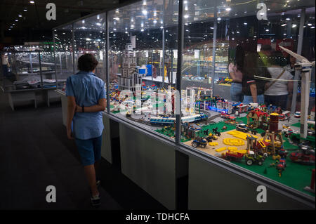 Malaga, Spain. 16th June, 2019. A boy looks at mock-ups displayed inside a glass cabinet during the exhibition. The LEGO exhibition is a temporary exhibition, the most biggest of Europe about figures of LEGO, showing different mockups mounted with more than 5 million of LEGO pieces to large scale such as Titanic ship, replicas of basketball players, the human body, characters of the film Star Wars, MARVEL and others. Credit: SOPA Images Limited/Alamy Live News - Stock Photo