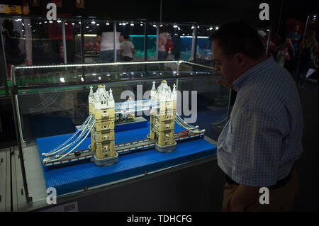 Malaga, Spain. 16th June, 2019. A man looks at mock-ups displayed inside a glass cabinet during the exhibition. The LEGO exhibition is a temporary exhibition, the most biggest of Europe about figures of LEGO, showing different mockups mounted with more than 5 million of LEGO pieces to large scale such as Titanic ship, replicas of basketball players, the human body, characters of the film Star Wars, MARVEL and others. Credit: SOPA Images Limited/Alamy Live News - Stock Photo