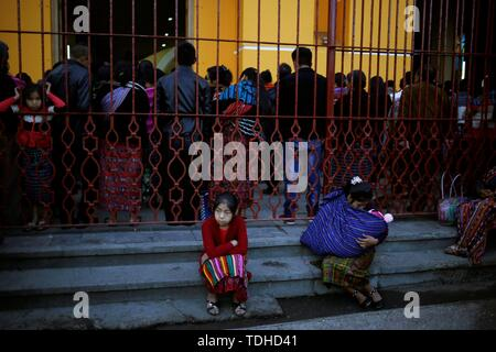 San Juan Sacatepequez, Guatemala. 16th June, 2019. People attend a mass in a church of indigenous municipality of San Juan Sacatepequez, Guatemala, 16 June 2019. Guatemala hold general elections to elect the President and Congress. Credit: Esteban Biba/EFE/Alamy Live News - Stock Photo