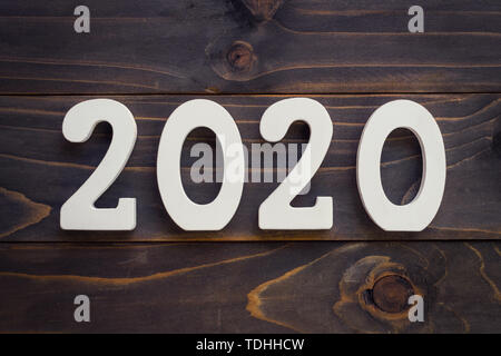 New year concept - Number 2020 for New Year on a wooden table. With vintage styled background. - Stock Photo