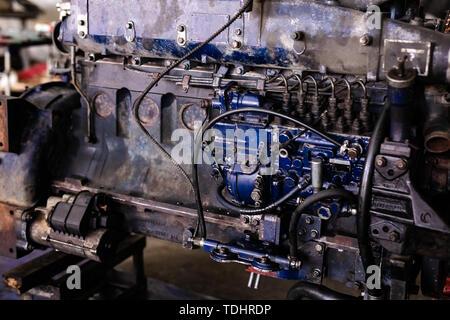 Mechanic opened the locking valve mechanism. Disassemble engine block vehicle. Old motor capital repair. Car service concept. - Stock Photo