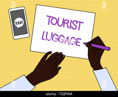 Handwriting text Tourist Luggage. Conceptual photo big bag that contains everything one needs for traveling Top View Man Writing Blank Paper Pen Penci - Stock Photo