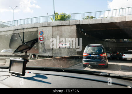 Paris, France - May 14, 2014: Driver POV point of view personal perspective at the traffic jam front driving cars entering Paris peripherique ring road highway - Stock Photo