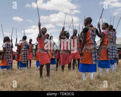 MASAI MARA, KENYA- 26, AUGUST, 2016: wide view of a group of maasai boys dancing at koiyaki guiding school, kenya - Stock Photo