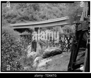 OPPOSITE VIEW OF PHOTO CA-216-3 SHOWING ORIGINAL WEST BANK FLUME PIER AT PHOTO LEFT CENTER AND NEW HIGHWAY 190 BRIDGE ABOVE FLUME. VIEW IS A 1998 DUPLICATION OF HISTORIC VIEW SHOWN IN PHOTO CA-216-11. VIEW TO NORTHWEST. - Tule River Hydroelectric Project, Water Conveyance System, Middle Fork Tule River, Springville, Tulare County, CA - Stock Photo