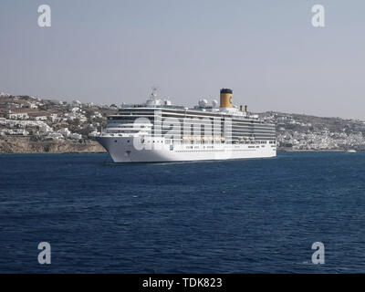 MYKONOS, GREECE- SEPTEMBER, 15, 2016: a cruise boat of the costa line moored at the greek island of mykonos - Stock Photo