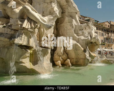 day time close up of rome's four rivers fountain in piazza navona, italy - Stock Photo