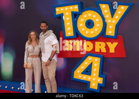 London, United Kingdom. 16 June 2019. Katie Wright and Rio Ferdinand attends the European Premiere of 'Toy Story 4' held at the Odeon Luxe, Leicester Square in central London. Credit: Peter Manning/Alamy Live News - Stock Photo